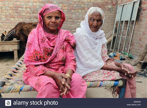 two old christian women sitting on a divan in the